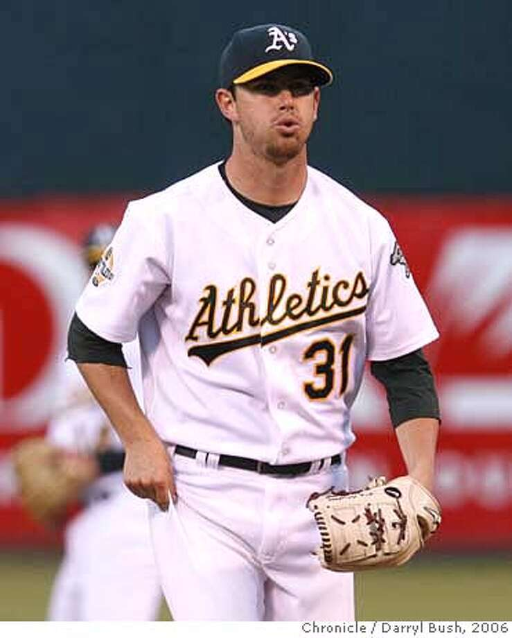 athletics_0006_db.JPG  Oakland Athletics pitcher Kirk Saarloos reacts to giving up two runs in the 4th inning vs. Arizona Diamondbacks at McAfee Coliseum in Oakland, CA on Friday, June 30, 2006. shot: 6/30/06  Darryl Bush / The Chronicle ** (roster) MANDATORY CREDIT FOR PHOTOG AND SF CHRONICLE/ -MAGS OUT Photo: Darryl Bush