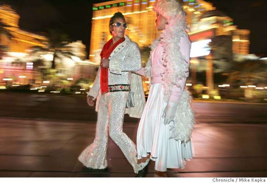 vegas1080_mk.jpg  From L.A. - Frankie D and Jenny T work their best impersonations of Elvis and Marilyn while passing through Vegas for a little action.  In to the night....Vegas Style - A photo essay on the sidewalks of the Vegas Strip after dark. 4/28/05 Mike Kepka / The Chronicle MANDATORY CREDIT FOR PHOTOG AND SF CHRONICLE/ -MAGS OUT Photo: Mike Kepka