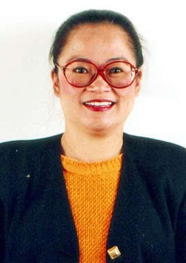 **FILE**Katrina Leung is shown in this 2000 file photo. Authorities say Leung, a high-profile Republican activist, used a decades-long affair with a retired FBI agent to spy for China. Leung, 49, was charged Thursday, April 10, 2003, with unauthorized copying of U.S. secrets with the intent of providing them to Chinese intelligence services. (AP Photo/courtesy Sing Tao Daily) Photo: SING TAO DAILY