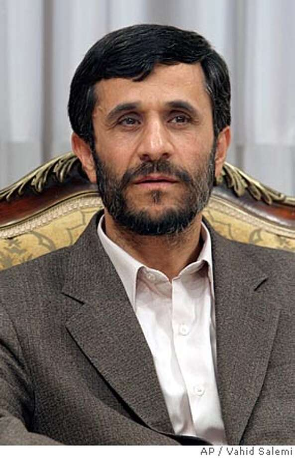 """Iran's President-elect, Mahmoud Ahmadinejad, listens to the Malian President Amadou Toumani Toure, unseen, during his first visit with a foreign leader since being elected on Friday, in Tehran, Iran, Thursday, June 30, 2005. Ahmadinejad on Monday, July 4, 2005, dismissed as """"baseless"""" allegations of his involvement in the 1979 hostage-taking at the U.S. Embassy in Tehran and in killing dissidents. (AP Photo/Vahid Salemi) Photo: VAHID SALEMI"""