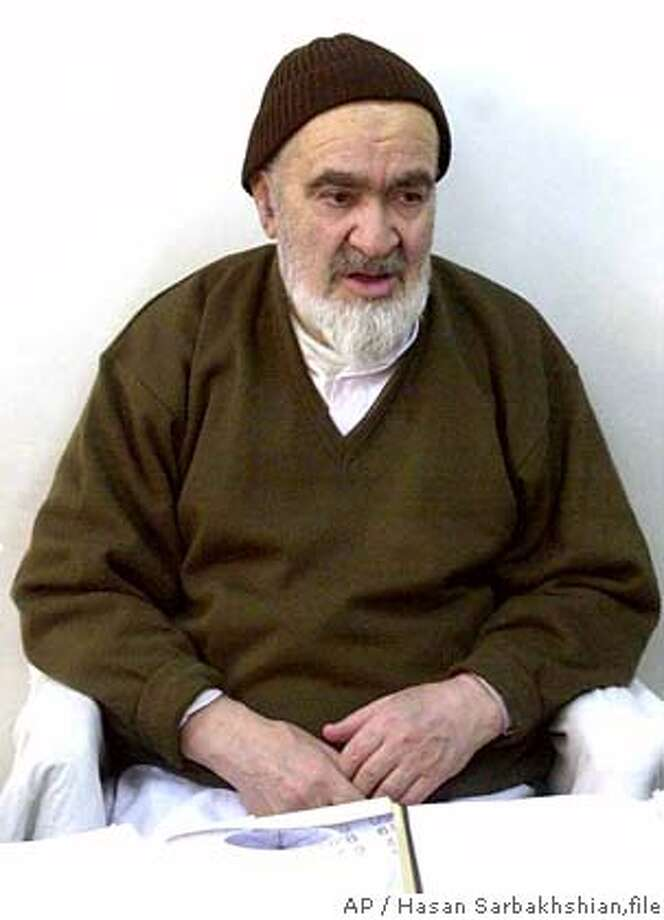 ** FILE ** Ayatollah Hossein Ali Montazeri, 81, Iran's most-senior dissident cleric, seen in this photo taken on Jan. 9, 2003, while under house arrest in Qom, Iran, 120 kms south of Tehran. Iranian authorities have lifted the house arrest of Iran's most-senior dissident cleric after five years, the official Islamic Republic News Agency reported Monday. The decision follows reports the cleric's health is deteriorating. .(AP Photo/Hasan Sarbakhshian,file) ALSO RAN 9/18/2003 Photo: HASAN SARBAKHSHIAN