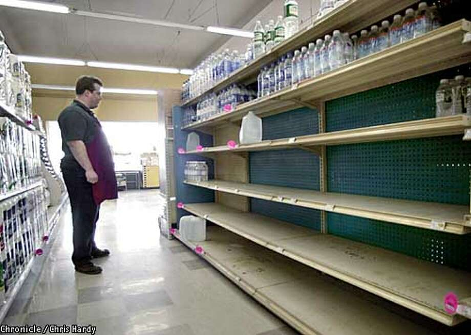 PACIFICANS TOLD TO BOIL THEIR TAP WATER AFTER A WATER MAIN BROKE. FOOD TOWN, A LOCAL SUPERMARKET, IS SELLING ALOT OF BOTTLED WATER. MANAGER STEVE MORRA WITH EMPTY SHELVES THAT ONCE HAD BOTTLED WATER  -----CHRONICLE PHOTO BY CHRIS HARDY Photo: Chris Hardy