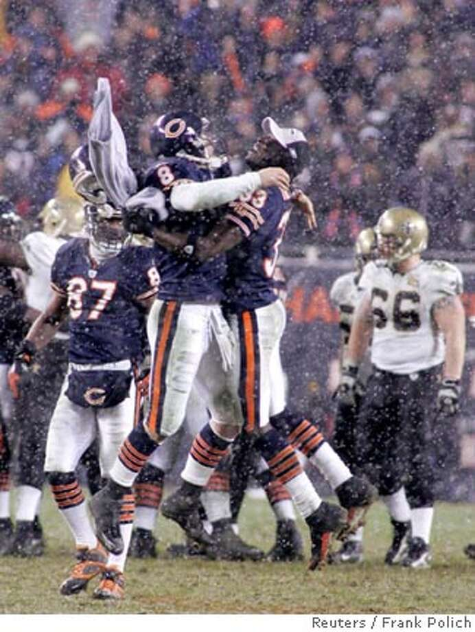 Chicago Bears quarterback Rex Grossman (8) and team mate Charles Tillman leap as they celebrate after their team defeated the New Orleans Saints in the NFL's NFC Championship football game in Chicago January 21, 2007. The Bears advance to play in the Super Bowl. At right is the Saints' Brian Young. REUTERS/Frank Polich (UNITED STATES)  Ran on: 01-22-2007 Photo: FRANK POLICH