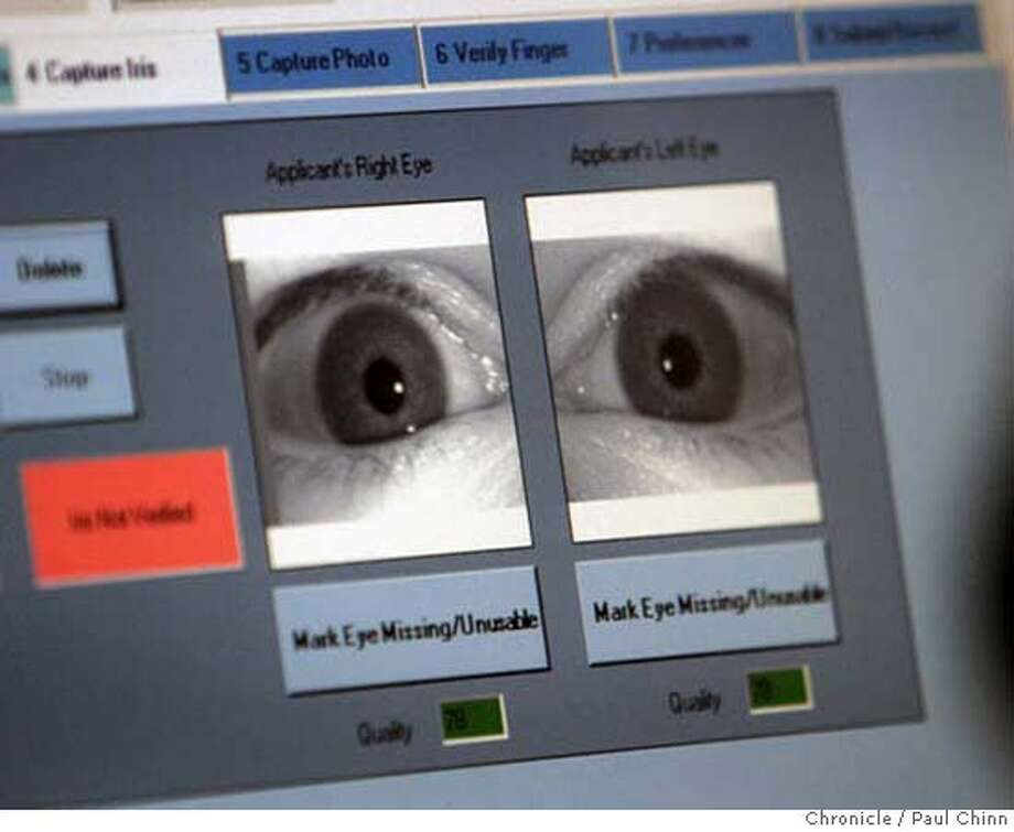Yotam Margalit's irises are scanned during the application process. In addition to the eye scan all ten fingerprints are recorded for the TSA background check. Officials at Mineta San Jose International Airport rolls out the new Clear Register Traveller Program in San Jose, Calif. on Tuesday, Jan. 23, 2007. After paying an annual $100 fee, pre-registered airline travelers can bypass the security checkpoint lines using a special biometric screening scanner saving up to 45 minutes of waiting time.  PAUL CHINN/The Chronicle  **Yotam Margalit MANDATORY CREDIT FOR PHOTOGRAPHER AND S.F. CHRONICLE/ - MAGS OUT Photo: PAUL CHINN