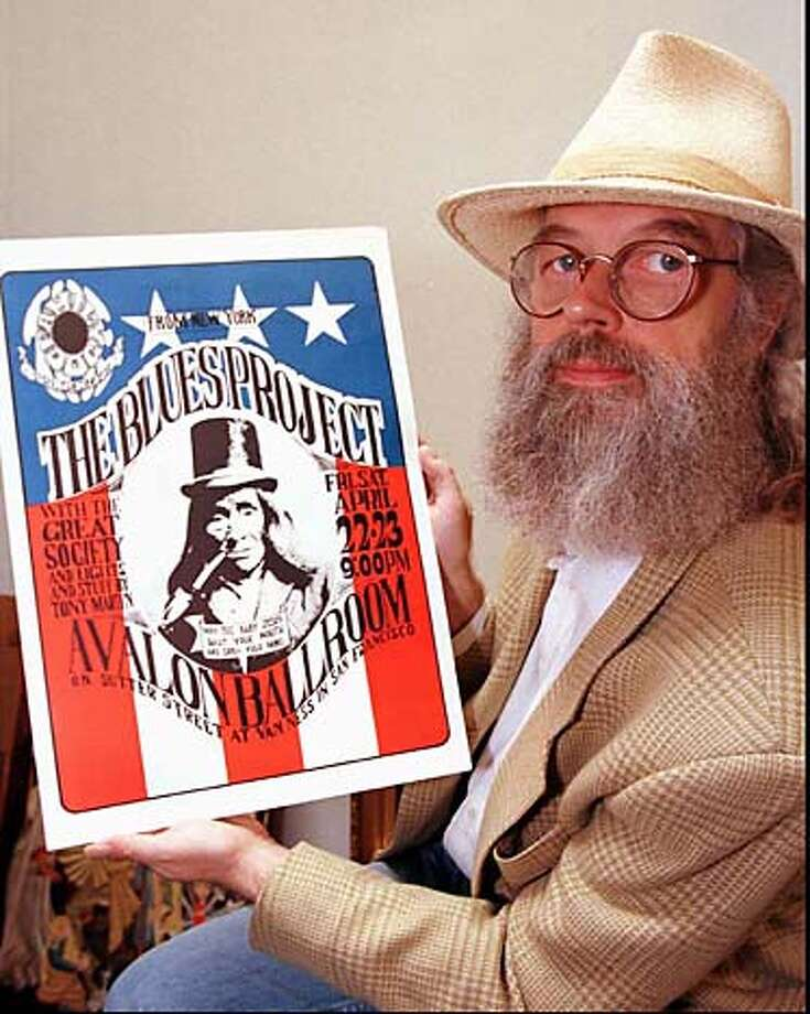 """** FILE ** Concert promoter Chet Helms displays a vintage concert poster from the 1960's """"Summer of Love"""" May 20, 1997, in a San Francisco file photo. Helms, the revered father of the 1967 Summer of Love and a music promoter who launched the career of singer Janis Joplin, died Saturday at California Pacific Medical Center of complications from a stroke, his wife said. He was 62. (AP Photo/Ben Margot, File) Photo: BEN MARGOT"""
