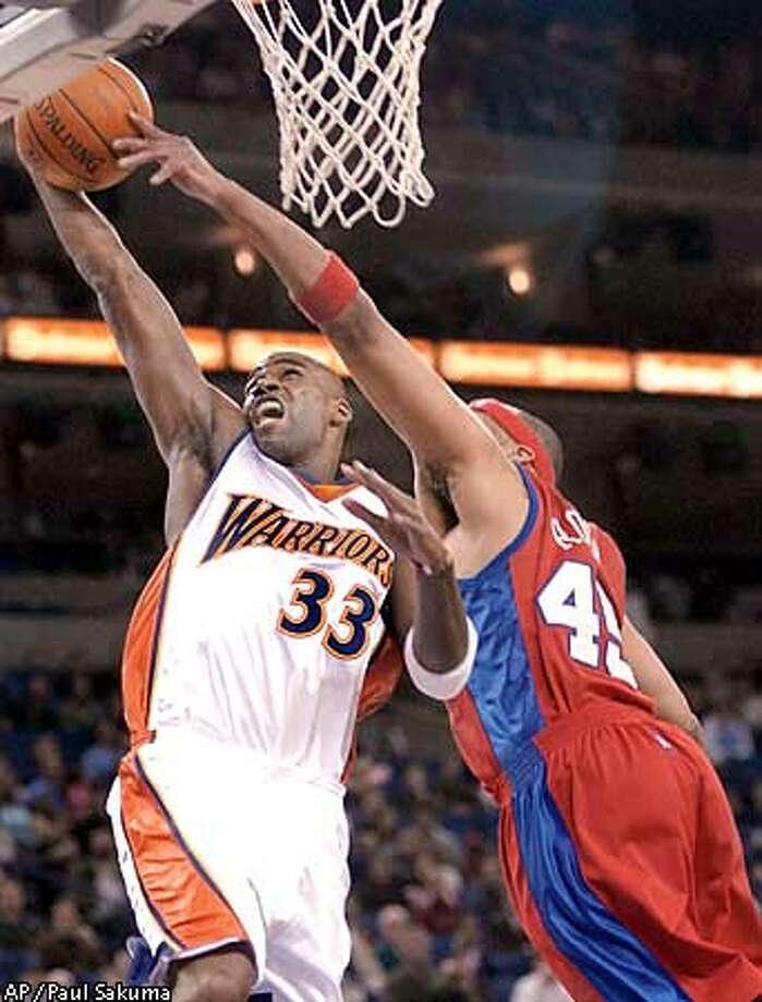 Golden State Warriors forward Antawn Jamison (33) has his shot blocked by Los Angeles Clippers center Sean Rooks in the first quarter, Monday, April 14, 2003, in Oakland, Calif. (AP Photo/Paul Sakuma) Photo: PAUL SAKUMA