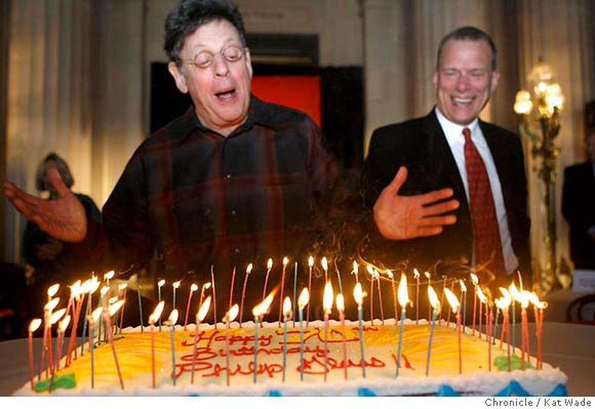 .jpg Composer Philip (CQ) Glass gets a surprise birthday cake (for his upcoming 70th birthday on Jan 31st during a press conference on Monday January 22, 2007 when San Francisco Opera general director David Gockley announced the 85th season which will include the world premiere of Glass's Appomattox. Kat Wade/The Chronicle Mandatory Credit for San Francisco Chronicle and photographer, Kat Wade, Mags out