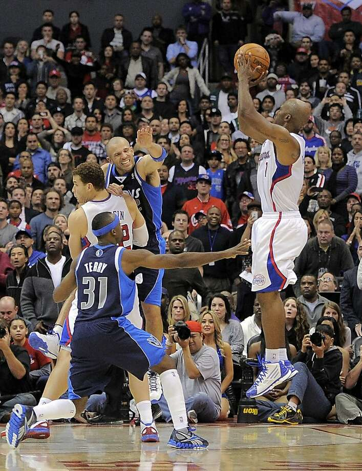 Los Angeles Clippers guard Chauncey Billups, right, shoots and hits a three point shot in the last few seconds of their NBA basketball game as Dallas Mavericks guard Jason Terry (31) defends along with guard Jason Kidd, center right, and Los Angeles Clippers forward Blake Griffin, top left,, Wednesday, Jan. 18, 2012, in Los Angeles. The Clippers won 91-89.  (AP Photo/Mark J. Terrill) Photo: Mark J. Terrill, Associated Press