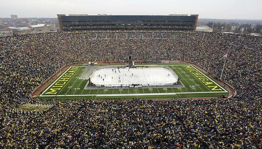 More than 100,000 fans watch the NCAA college hockey game between Michigan and Michigan State at Michigan Stadium in Ann Arbor, Mich., Saturday, Dec. 11. 2010.. Photo: Carlos Osorio, AP