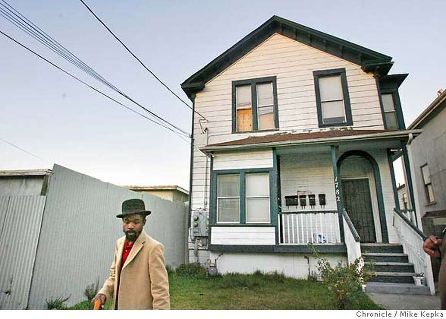 �villagebottoms00017_mk.JPG Diallo walks past one a historic West Oakland property that he plans to turn into condos for black artist. West Oakland entrepreneur, Marcel Diallo,34, is racing against the gentrification clock to create an enclave of all things African-American in his neighborhood. He has a plan to create more black homeowners, black-owned cafes, galleries, boutiques and mom-and-pop shops. His vision is to call his West Oakland Neighborhood the Village Bottoms Cultural District. Mike Kepka / The Chronicle Marcel Diallo (cq) the source MANDATORY CREDIT FOR PHOTOG AND SF CHRONICLE/ -MAGS OUT Photo: Mike Kepka