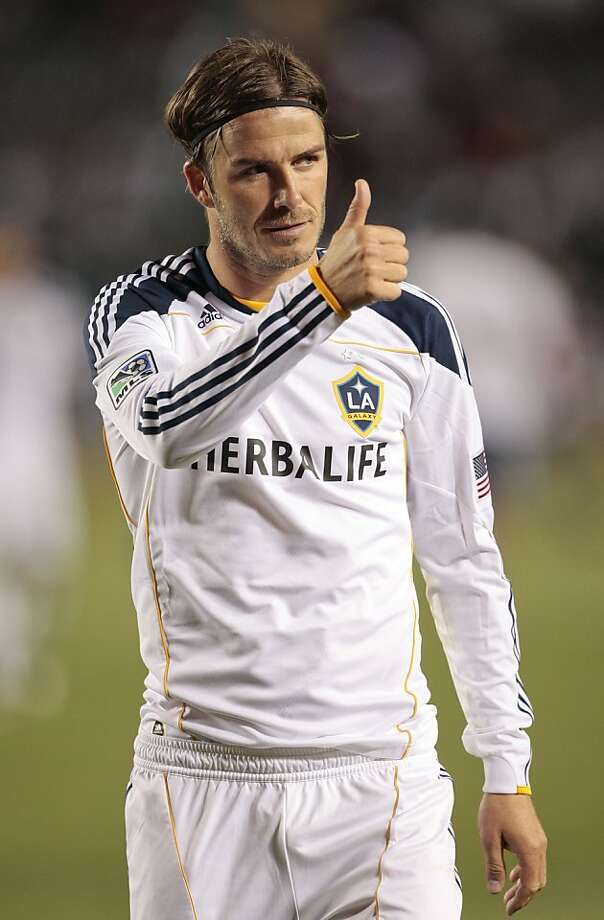 "FILE - In this May 21, 2011 file photo, Los Angeles Galaxy midfielder David Beckham of England gives a thumbs up after a MLS soccer match against Chivas USA, in Carson, Calif., USA. David Beckham is not yet a Paris Saint-Germain player, with French reports that a deal has been completed being described as ""premature"" by his management company. (AP Photo/Jason Redmond, File) Photo: Jason Redmond, Associated Press"