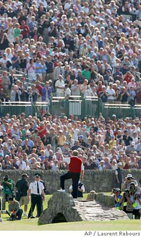 Golf legend Jack Nicklaus waves to spectators from the Swilcan Bridge on the 18th hole as he comes close to the end of playing his final round ever in the British Open golf championship on the Old Course at St. Andrews, Scotland Friday July 15, 2005. (AP Photo/Laurent Rebours) EDITORIAL USE ONLY Photo: LAURENT REBOURS