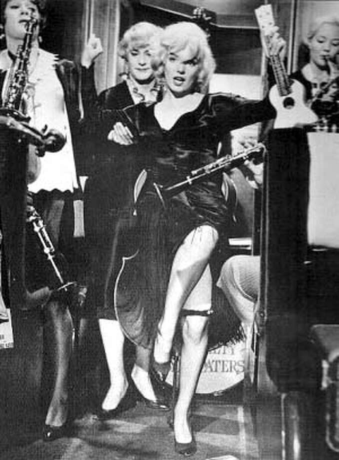 """�Tony Curtis, Jack Lemmon and Marilyn Monroe in """"Some Like It Hot'' for filmgoer28 Ran on: 11-28-2004 Tunde Kelani's &quo;Campus Queen,&quo; a mix of the thriller and caper genres, is one of the Nigerian director's films and videos being presented in a special program at 3 p.m. Friday and again on Dec. 10 and 17 at Yerba Buena Center for the Art's Screening Room. Photo: HANDOUT"""