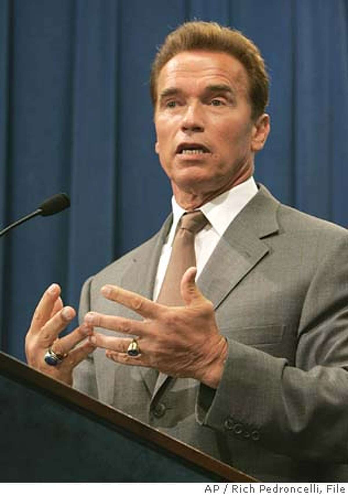 Gov. Arnold Schwarzenegger called for more bipartisan efforts between his office and Democratic lawmakers to reach a budget agreement and find compromise on measures pending on the November ballot, during a Capitol news conference held in Sacramento, Calif., Tuesday, June 21, 2005. According to the Field Poll released Tuesday, 37 percent of registered California voters approve of Schwarzenegger's job performance, a drop of 18 percentage points since February. (AP Photo/Rich Pedroncelli) Ran on: 06-22-2005 Gov. Arnold Schwarzenegger calls for more bipartisan budget efforts, even as he attacks the Democrats plan as irresponsible and full of red ink. Ran on: 07-09-2005 Assembly Speaker Fabian N��ez and Gov. Arnold Schwarzenegger have been getting along much better in recent weeks. Ran on: 07-09-2005 Assembly Speaker Fabian N��ez and Gov. Arnold Schwarzenegger have been getting along much better in recent weeks.