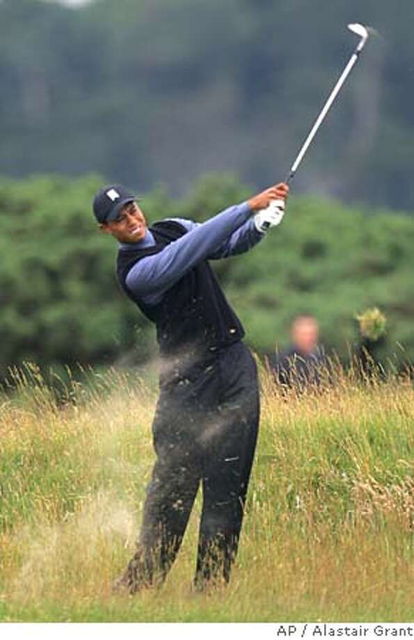Tiger Woods of the United States plays from the 6th fairway during the first round of the British Open golf championship on the Old Course at St. Andrews, Scotland Thursday July 14, 2005. (AP Photo/Alastair Grant) EDITORIAL USE ONLY Photo: ALASTAIR GRANT