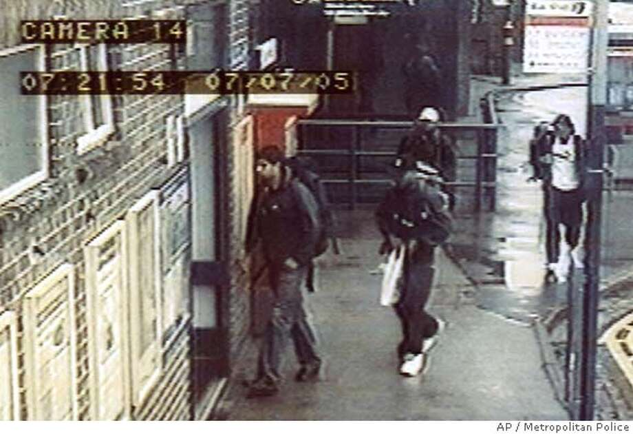 In this CCTV image made available in London Saturday July 16, 2005, by the Metropolitan Police, the four London bombers are seen arriving at Luton railway station at 0721 local time on Thursday July 7 , 2005. The image shows from left to right Hasib Hussain, Germaine Lindsay, dark cap, Mohammed Sidique Khan, light cap, and Shahzad Tanweer.(AP Photo/Metropolitan Police, ho)
