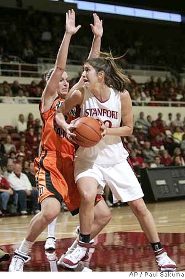 Stanford center Brooke Smith, right, drives to the basket in front of Oregon State forward Casey Nash, left, in the second half of their NCAA basketball game in Stanford, Calif., Saturday, Jan. 20, 2007. Smith was Stanford's high scorer with 17 points and Nash was Oregon State's high-scorer with 20 points. Stanford defeated Oregon State, 69-55. (AP Photo/Paul Sakuma) Photo: PAUL SAKUMA