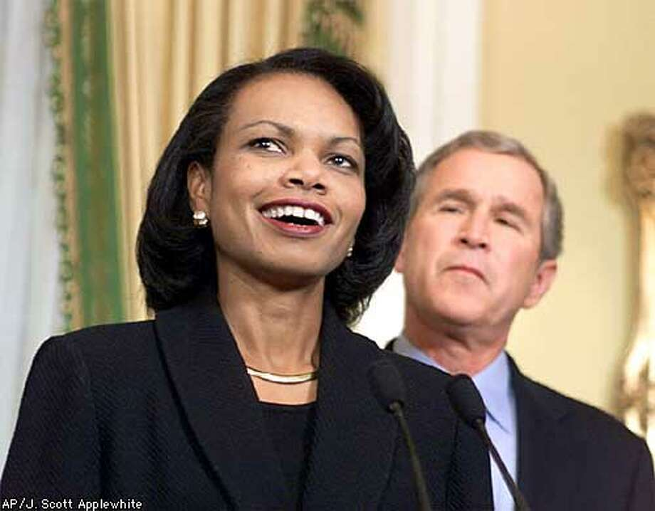 President-elect Bush listens to Condoleezza Rice, left, after naming her to serve as his national security adviser, during a ceremony at the Governor's Mansion in Austin, Texas, Sunday, Dec. 17, 2000. Rice, 46, who served in the administration of former President George Bush, will be President-elect Bush's top foreign policy adviser. (AP Photo/J. Scott Applewhite) Photo: J. SCOTT APPLEWHITE