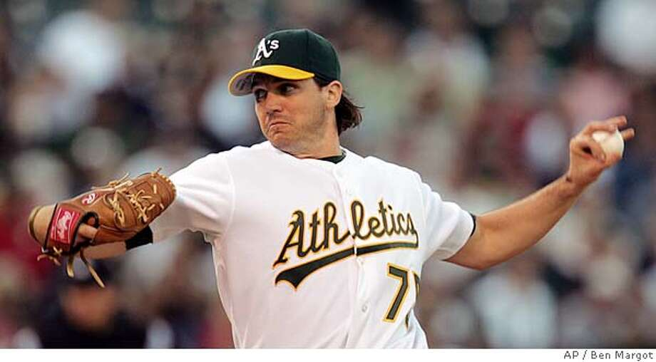 Oakland Athletics' Barry Zito works against the Texas Rangers in the first inning Friday, July 15, 2005, in Oakland, Calif. (AP Photo/Ben Margot) Photo: BEN MARGOT