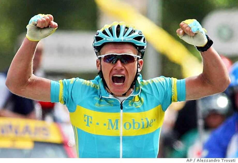 Alexandre Vinokourov of Kazakhstan reacts as he crosses the finish line to win the 11th stage of the Tour de France cycling race between Courchevel and Briancon, French Alps, Wednesday, July 13, 2005. (AP Photo/Alessandro Trovati) Photo: ALESSANDRO TROVATI