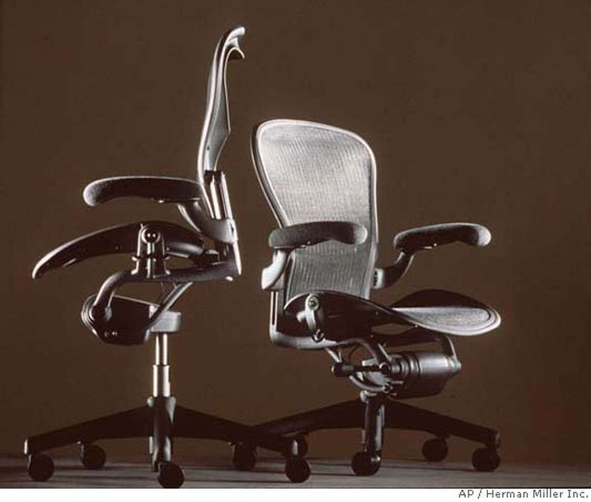 FOR USE ANYTIME--FILE--Aeron chairs designed by Herman Miller Inc. are seen in this undated photo. The top-selling, ulta-sleek Aeron chair is the target of the new Leap chair from Steelcase Inc. as the furniture titans are finding an increasing market for more expensive ergonomic seating. (AP Photo/Herman Miller Inc.) FOR USE ANYTIME. UNDATED HANDOUT PHOTO