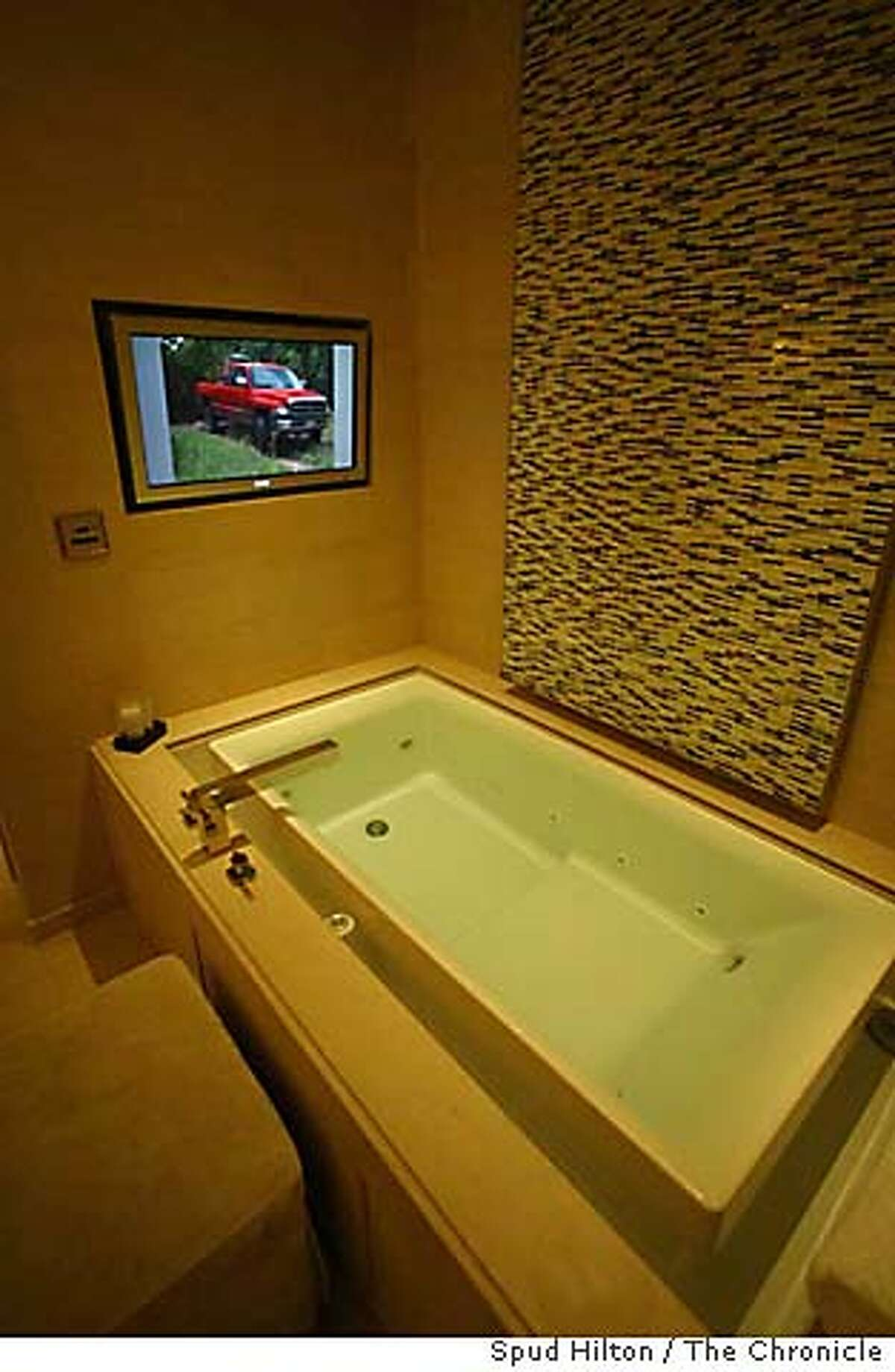 """The master bathroom in the Skylofts at MGM Grand are equipped with an """"infinity bathtub"""" that has its own TV with premium cable. Chronicle photo by Spud Hilton"""