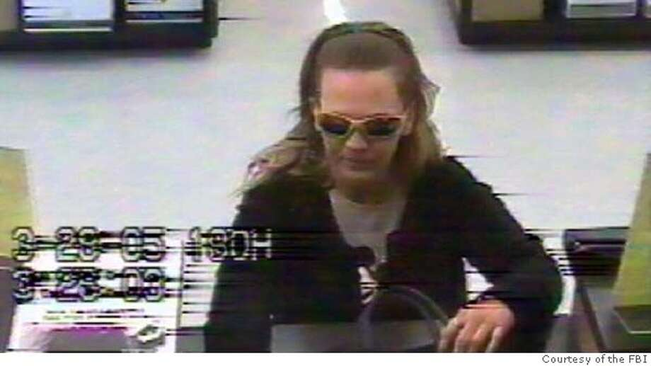 "Security camera image of the ""BAG LADY BANDIT."" Photo: Courtesy of the FBI The FBI has released this security camera image of a woman agents call the &quo;bag lady bandit.&quo; Photo: Courtesy Of The FBI"