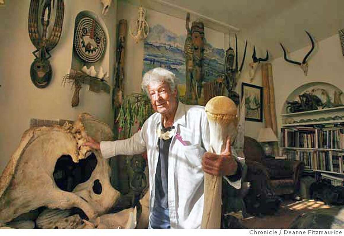 Ray is in his living room with an elephant pelvis and femur (thigh bone). Ray Bandar is a biologist who collects animal skulls. He has 6,000 animal skulls in his home. Photographed in San Francisco on 1/17/07. Photo / Deanne Fitzmaurice