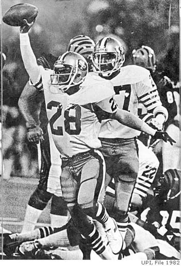 .jpg January 24, 1982 - After Cris Collinsworth of the Bengals was stripped of the ball in the second quarter, 49ers Lynn Thomas (28) recovers it on the 49er eight yard line and rejoices. PHOTO CREDIT: UPI Photo: PHOTO CREDIT: