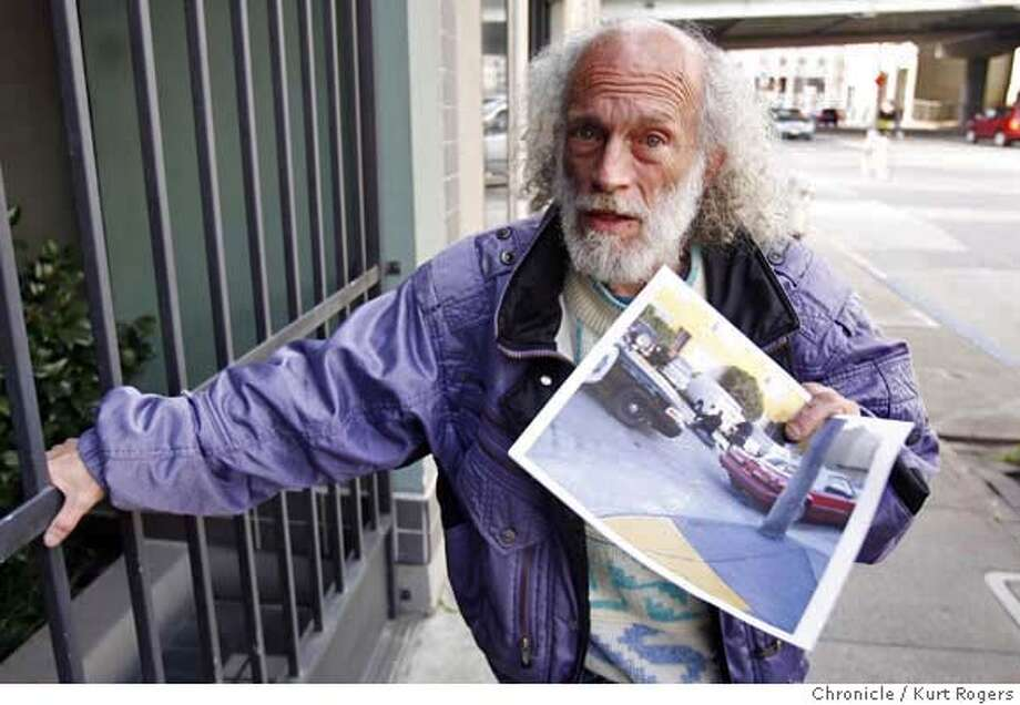 Richard Stypman with a photo he took of a man being baton by police. the man later died.  FRIDAY, JANUARY 19, 2007 KURT ROGERS/THE CHRONICLE SAN FRANCISCO THE CHRONICLE  SFC COPBEATING_0016_kr.jpg MANDATORY CREDIT FOR PHOTOG AND SF CHRONICLE / -MAGS OUT Photo: KURT ROGERS/THE CHRONICLE