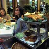 Peking duck on a rolling cart at Yank Sing in Rincon Center. Diane Gorczyca (left) and Kelly Drumm (glasses) having a lunch break at Yank Sing. (PHOTOGRAPHED BY LIZ HAFALIA/THE SAN FRANCISCO CHRONICLE)