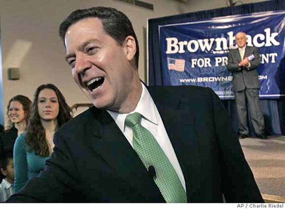 Sen. Sam Brownback, R-Kan., greets the crowd after announcing his intention to run for president Saturday, Jan. 20, 2007 in Topeka, Kan. Brownback called for a renewal of the nation's cultural values and a focus on rebuilding families. (AP Photo/Charlie Riedel) Photo: CHARLIE RIEDEL
