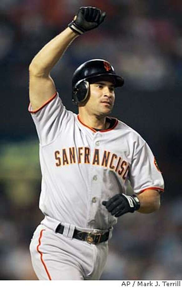 San Francisco Giants' Omar Vizquel reacts after hitting a three-run home run against the Los Angeles Dodgers during the inning, Thursday night, July 14, 2005, in Los Angeles. (AP Photo/Mark J. Terrill) Photo: MARK J. TERRILL