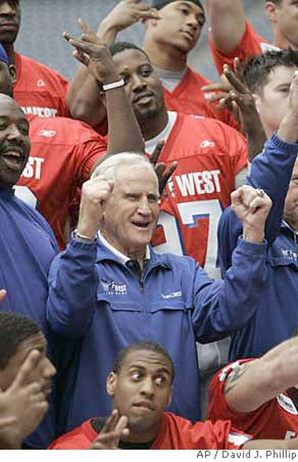 Don Shula, center, raises his arms along with his East team players during a team photo session Friday, Jan. 19, 2007 in Houston. Shula will coach the East team and Dan Reeves will coach the West team in the East West Shrine game Saturday. (AP Photo/David J. Phillip) Photo: David J. Phillip