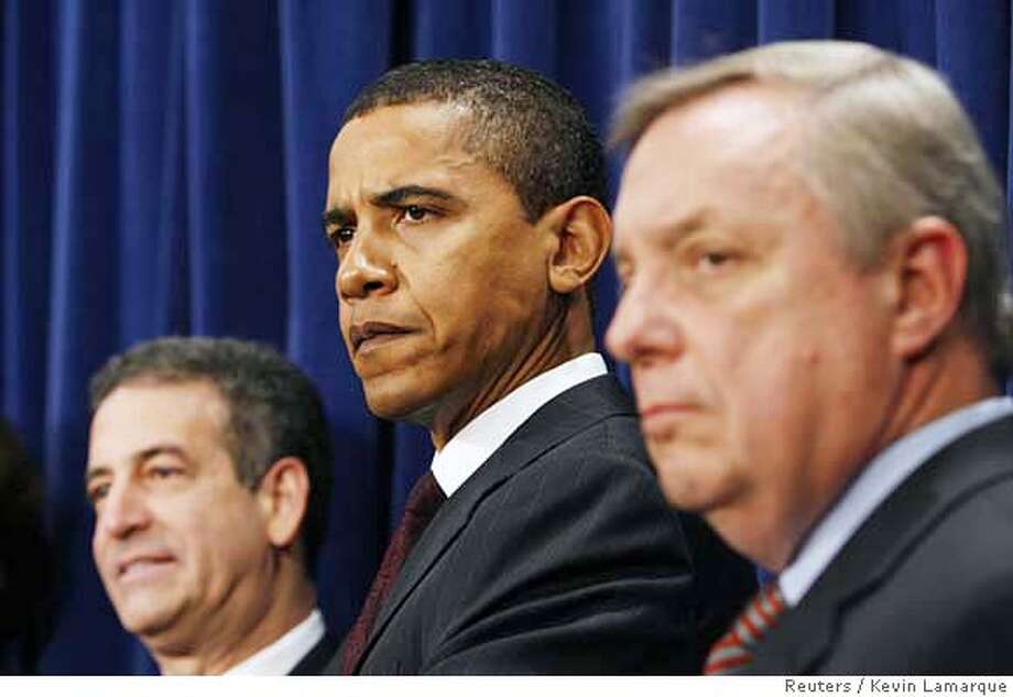 Senators Russell Feingold (L) (D-WI), Barack Obama (C) (D-IL) and Dick Durbin (D-IL) listen during a news conference about ethics reform with other Democratic Senators in the Capitol in Washington January 18, 2007. Two weeks after the U.S. Senate convened with Democrats and Republicans vowing to work together for the public good, they bitterly split on Wednesday over how to clean up the scandal-rocked U.S. Congress. REUTERS/Kevin Lamarque (UNITED STATES) 0 Photo: KEVIN LAMARQUE