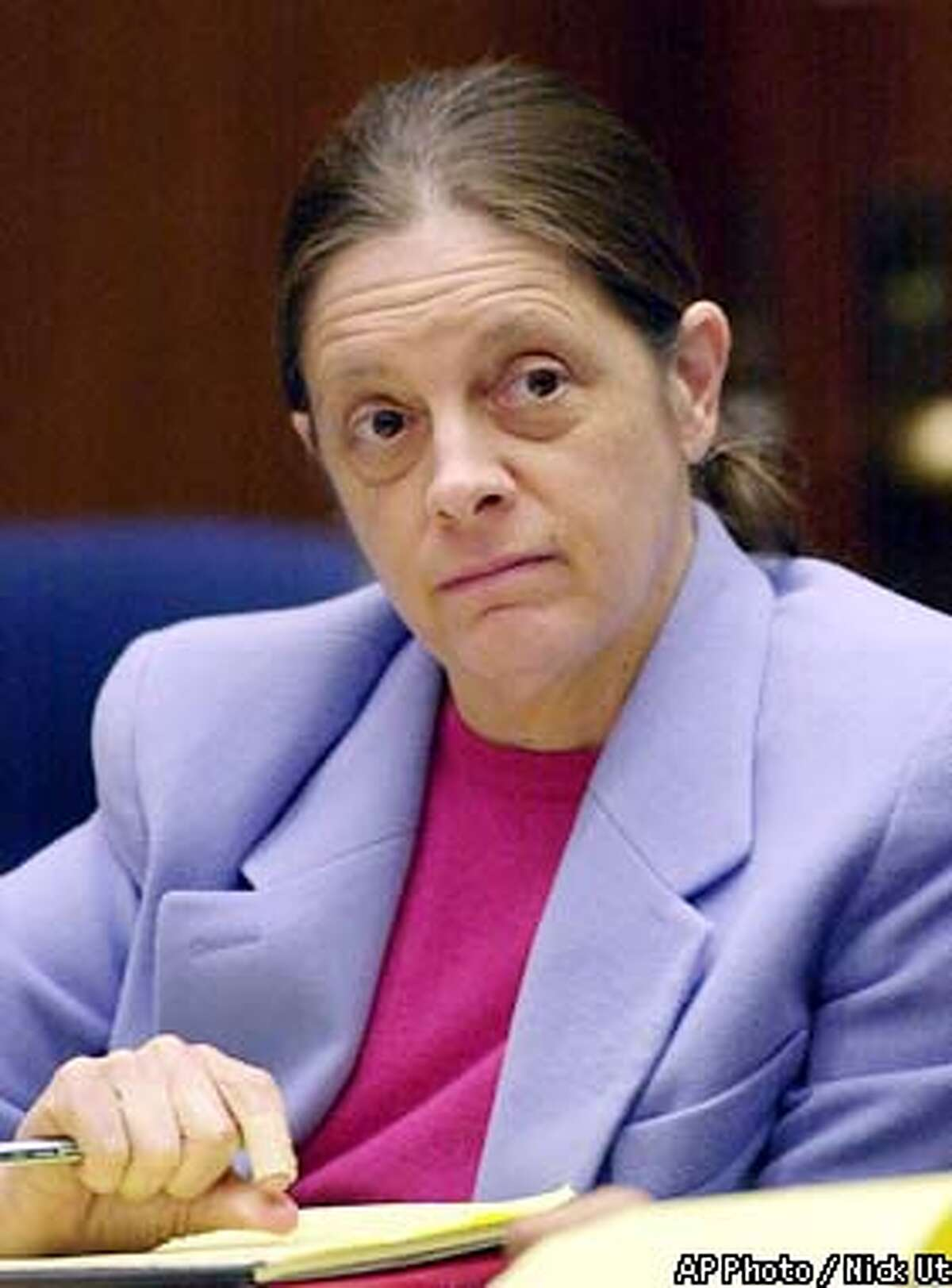 Chief defendant Marjorie Knoller listens to closing arguments in the San Francisco dog mauling trial Monday, March 18, 2002, at the Los Angeles County Courthouse in Los Angeles. Knoller, who was present when two dogs she and her husband kept attacked neighbor Diane Whipple in a hallway of their San Francisco apartment building on Jan. 26, 2001, is charged with second-degree murder. Knoller, 46, and her husband Robert Noel, 60, are both charged with involuntary manslaughter and keeping a mischievous dogthat killed a person. (AP Photo/Nick Ut, Pool)