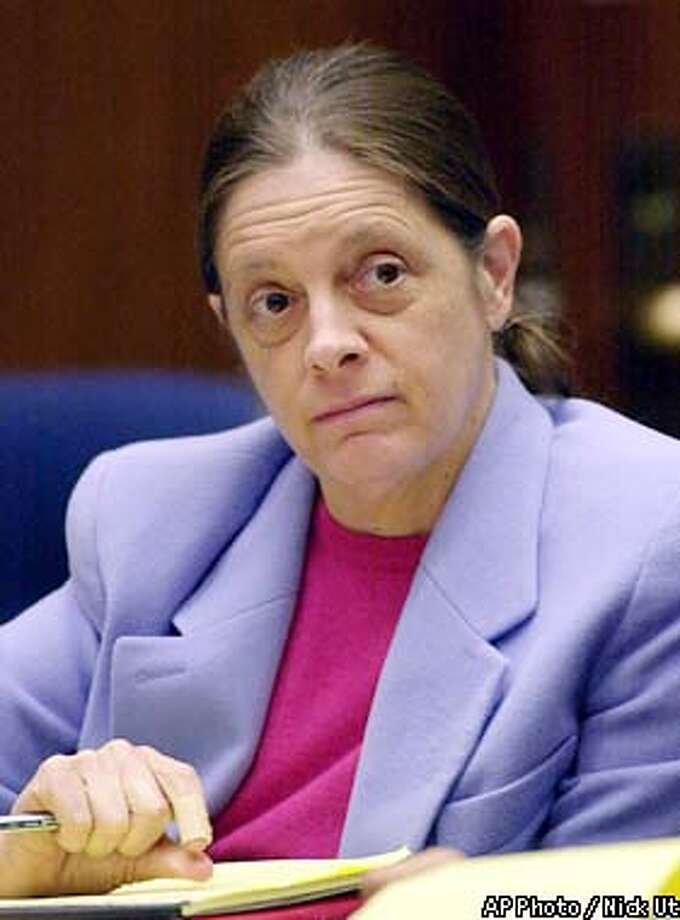 Chief defendant Marjorie Knoller listens to closing arguments in the San Francisco dog mauling trial Monday, March 18, 2002, at the Los Angeles County Courthouse in Los Angeles. Knoller, who was present when two dogs she and her husband kept attacked neighbor Diane Whipple in a hallway of their San Francisco apartment building on Jan. 26, 2001, is charged with second-degree murder. Knoller, 46, and her husband Robert Noel, 60, are both charged with involuntary manslaughter and keeping a mischievous dogthat killed a person. (AP Photo/Nick Ut, Pool) Photo: NICK UT