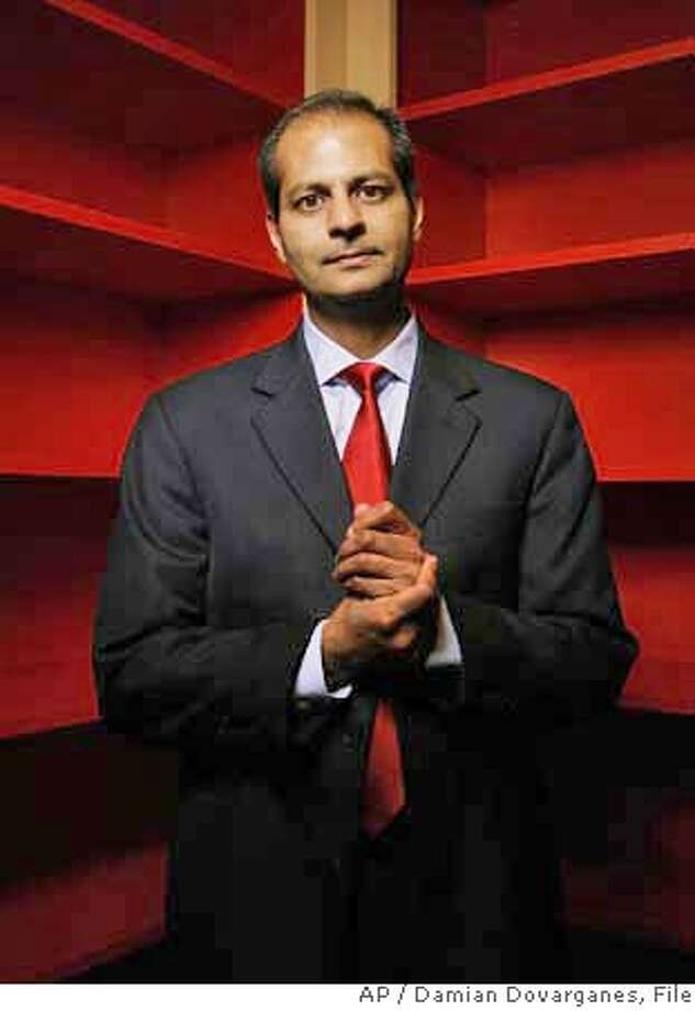 ** FILE ** Hemanshu Nigam, chief security officer at Fox Interactive Media, poses for a photo in an empty library at their office in Beverly Hills, Calif.,in this Dec. 20, 2006 file photo. Four families have sued News Corp. and its MySpace social-networking site after their underage daughters were sexually abused by adults they met on the site, lawyers for the families said Thursday, Jan. 18, 2007. (AP Photo/Damian Dovarganes, file) **FILE** Photo: DAMIAN DOVARGANES
