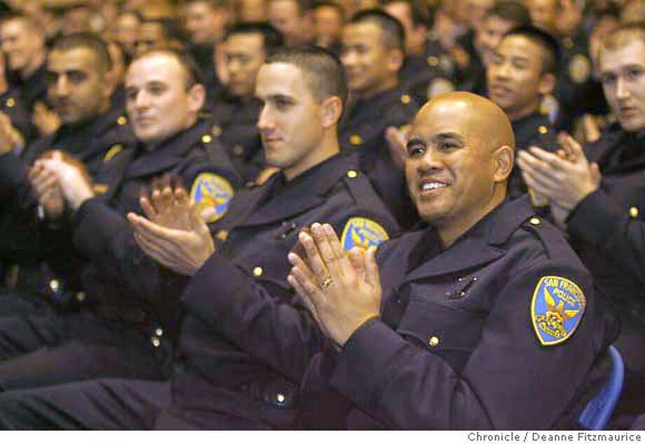 The 212th San Francisco Police Department Academy Class holds its graduation ceremony at George Washington High School. Photographed in San Francisco on 1/19/07. Photo / Deanne Fitzmaurice Photo: Deanne Fitzmaurice