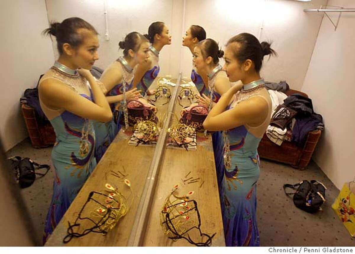 ETHNICDANCE Looking into the mirror, fixing themselves up in costume is, farthest away, is Yang Yang, in middle is, Xue Bing Xu, and closest is, Jing Chang The ethnic dance festival auditions at the Palace of Fine Arts. Event on 1/14/07 in San Francisco. Penni Gladstone / The Chronicle