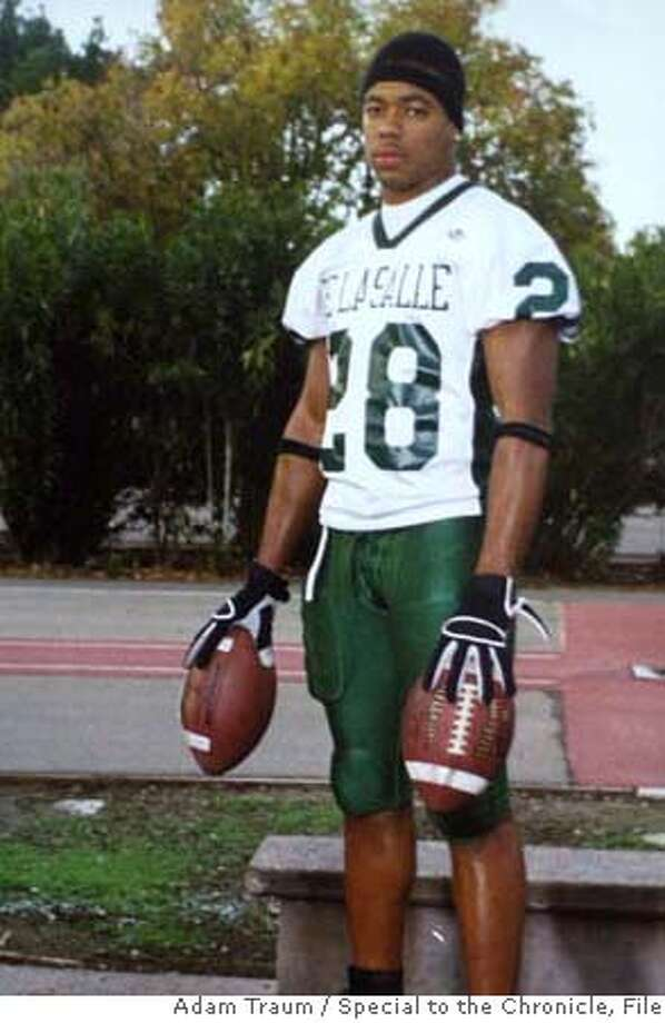 {060404_oakslay05_ckh) Copy photo of De LaSalle football star Terrance Kelly in his high school uniform. Richmond Police have already arrested the 18 year old Larry Pratcher of Richmond in the slaying of De LaSalle football star Terrance Kelly {08/16/04} in {Richmond}. {Adam Traum} / {SF CHRONICLE} Ran on: 08-20-2004  Darren Pratcher Ran on: 08-20-2004  Darren Pratcher  Ran on: 08-03-2006  Landrin Kelly stands in his Suisun City home amid mementos of his son, Terrance Kelly, a former De La Salle High School football star who was fatally shot in Richmond in 2004. Below right: A Sept. 27, 2003, article in The Chronicle about the game in which Kelly scored three touchdowns.  Ran on: 08-03-2006  Landrin Kelly stands in his Suisun City home amid mementos of his son, Terrance Kelly (below left), a De La Salle High School football star who was killed in Richmond in 2004. Below right: A Sept. 27, 2003, article in The Chronicle about the game in which Kelly scored three touchdowns.  Ran on: 08-03-2006  Landrin Kelly stands in his Suisun City home amid mementos of his son, Terrance Kelly (below left), a De La Salle High School football star who was killed in Richmond in 2004. Below right: A Sept. 27, 2003, article in The Chronicle about the game in which Kelly scored three touchdowns.  Ran on: 08-24-2006  Terrance Kelly, who played football for De La Salle High School in Concord, was ambushed in Richmond as he sat in his car.  Ran on: 09-08-2006  Terrance Kelly, above, was killed on Aug. 12, 2004. Darren Pratcher, left, is being tried as an adult in the slaying.  Ran on: 09-08-2006 Ran on: 09-08-2006 Ran on: 09-08-2006  Terrance Kelly, right, was killed on Aug. 12, 2004. Darren Pratcher, above, is being tried as an adult in the slaying.  Ran on: 09-13-2006  Terrance Kelly was shot to death less than two days before he was to leave for the University of Oregon.  Ran on: 09-13-2006  Terrance Kelly was shot to death less than two days before he was to leave for the University of