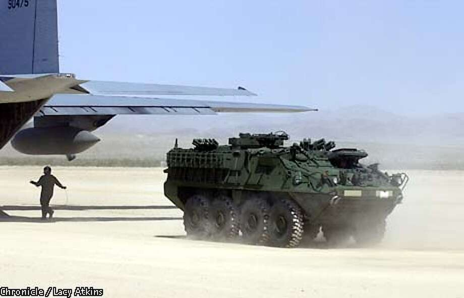 The Army's newest mobile unit, known as the Stryker drives off an Airforces carrier plane at Ft. Irwin, for it's final test, Wed. April 9, 2003.The Stryker is a fighting vehicle similar to the Bradley with the noticeable difference being that it has wheels.  SAN FRANCISCO CHRONICLE/LACY ATKINS Photo: LACY ATKINS