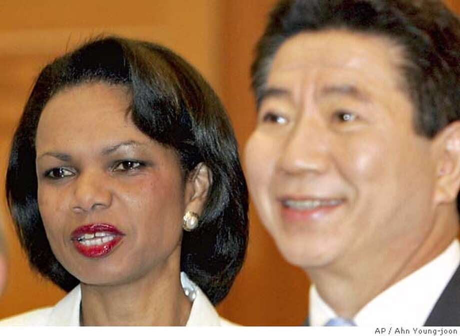 U.S. Secretary of State Condoleezza Rice, left, meets with South Korean President Roh Moo-hyun at the presidential house in Seoul, Wednesday, July 13, 2005. Rice and top South Korean officials on Wednesday focused on revived nuclear disarmament talks with North Korea after a 13-month freeze, a day after Seoul said it offered massive energy aid to its impoverished neighbor to entice it back to the negotiations. Rice is in Seoul on the last stop of an Asian tour before returning to Washington later Wednesday.(AP Photo/Ahn Young-joon. Pool) POOL Photo: AHN YOUNG-JOON
