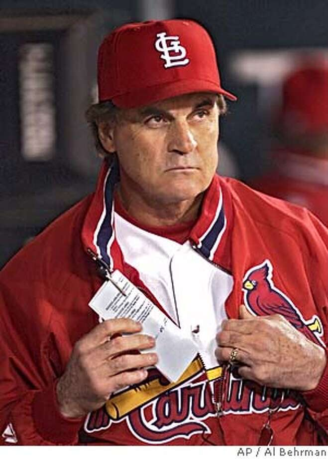 St. Louis Cardinals manager Tony LaRussa watches the action in the firth inning during Game 1 of the National League Championship Series against the Houston Astros Wednesday, Oct. 13, 2004, in St. Louis. (AP Photo/Al Behrman) Ran on: 10-14-2004  Cardinals manager Tony La Russa is in his ninth League Championship Series. ALSO Ran on: 01-09-2005 Tony La Russa could match Red Schoendienst as second longest Cardinals manager -- 12 years -- if his contract runs its course. Ran on: 04-07-2005  FERC Chairman Patrick Wood Ran on: 04-07-2005  FERC Chairman Patrick Wood Photo: AL BEHRMAN