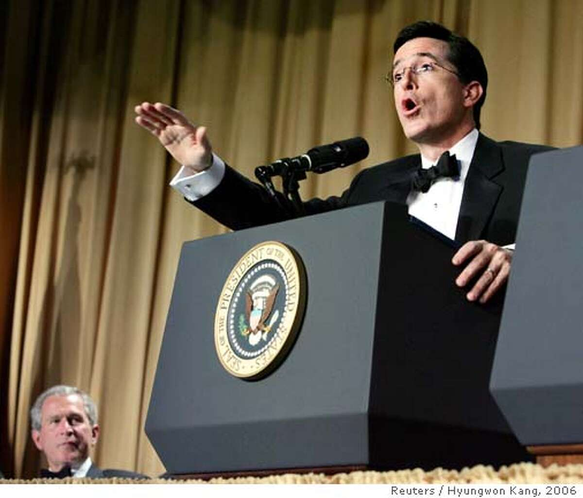 Comedian Stephen Colbert (R) provides the entertainment as U.S. President George W. Bush (L) watches during the White House Correspondents' Association Dinner in Washington, April 29, 2006. REUTERS/Hyungwon Kang Ran on: 05-07-2006 Ran on: 12-31-2006 Mel Gibsons mouth got him in trouble (his mug shot is inset). Stephen Colberts speech told it like it was in Washington, above right.