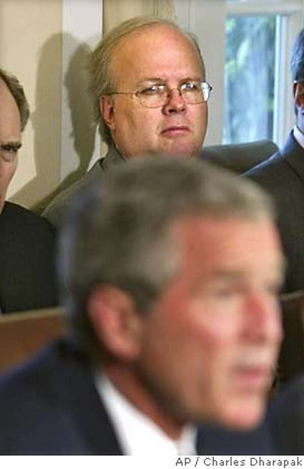 **FILE** Chief political strategist Karl Rove listens as President Bush speaks to reporters in the Cabinet Room at the White House in a Wednesday, Sept. 17, 2003 photo, in Washington. After two days of questions, the White House said Tuesday, July 12, 2005, that President Bush continues to have confidence in Karl Rove, the presidential adviser at the center of the investigation into the leak identifying a female CIA officer. (AP Photo/Charles Dharapak) Photo: CHARLES DHARAPAK