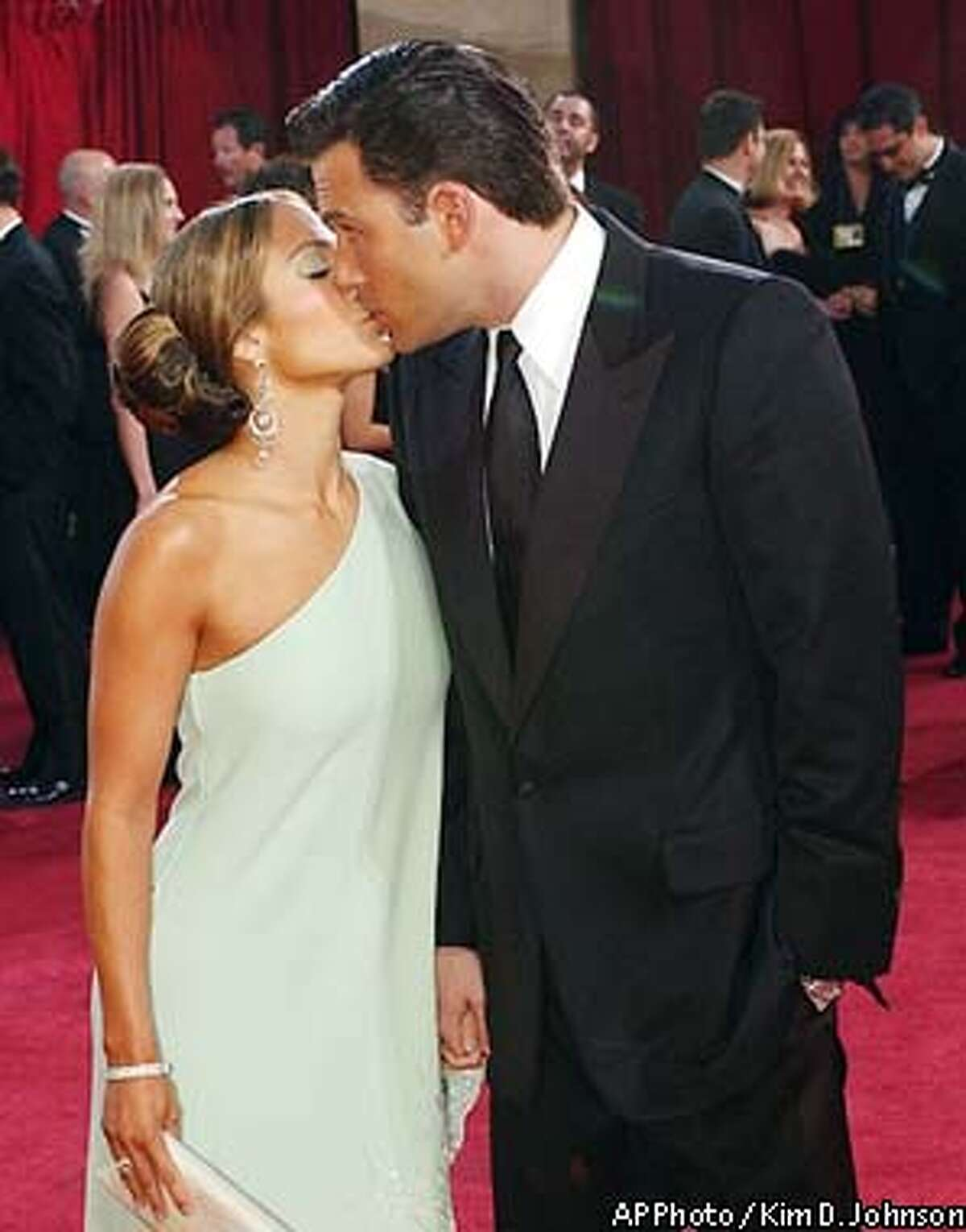 Actors Jennifer Lopez and her fianc Ben Affleck kiss during their arrival for the 75th annual Academy Awards Sunday, March 23, 2003, in Los Angeles where they will be presenters during the show. (AP Photo/(AP Photo/Kim D. Johnson)