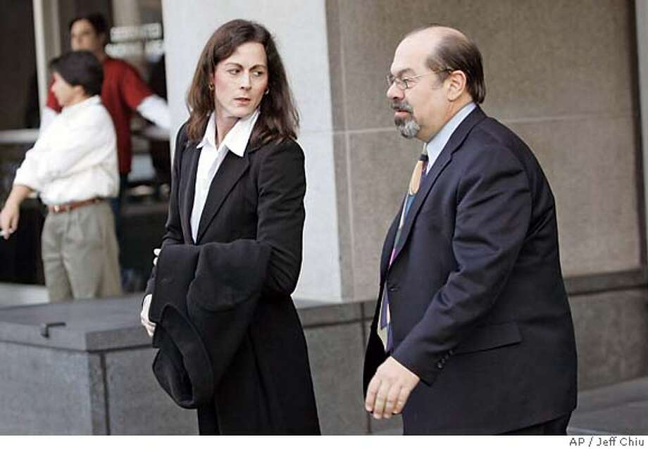 Former elite cyclist Tammy Thomas, left, leaves the federal courthouse with her attorney Tony Tamburello in San Francisco, Friday, Jan. 19, 2007. Thomas pleaded not guilty in federal court Friday to charges of lying to a grand jury investigating steroid use in sports. Thomas, the first athlete charged in a probe that has implicated some of the biggest stars in baseball and track and field, is charged with three counts of perjury and one count of obstruction of justice. (AP Photo/Jeff Chiu) Photo: Jeff Chiu