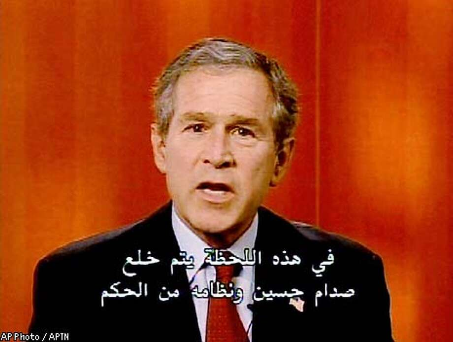 "President Bush, seen in this image from video, in remarks televised throughout Iraq Thursday, April 10, 2003, tells citizens of the war-torn nation ""at this moment, the regime of Saddam Hussein is being removed from power."" The remarks were recorded Tuesday in Northern Ireland where Bush was met with Britain's Prime Minister Tony Blair. (AP Photo / APTN)"