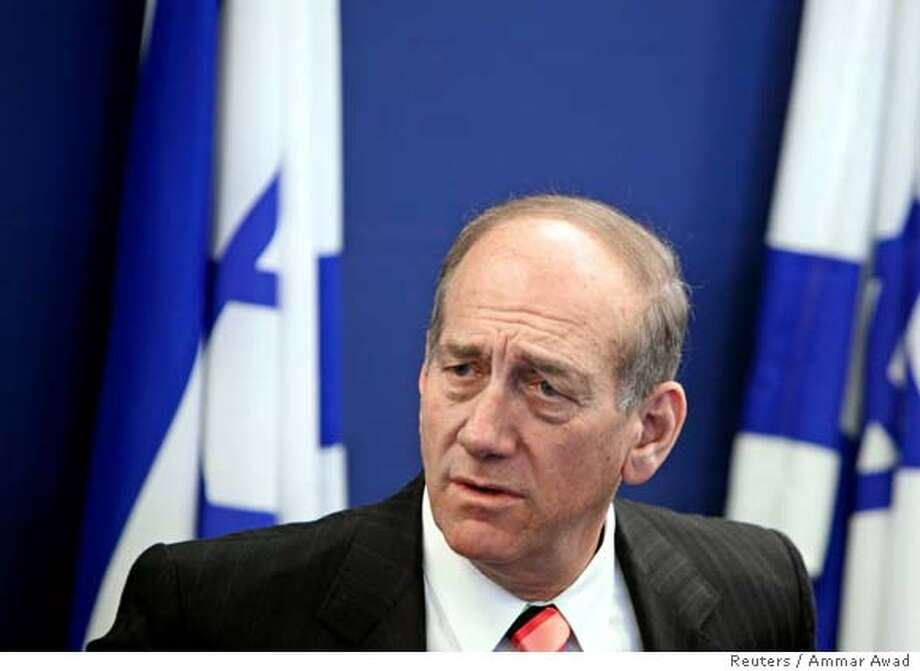 Israeli Finance Minister Ehud Olmert announces the sale of the government's holdings of Bank Leumi during a news conference in Jerusalem in this file picture taken November 15, 2005. Israel's state prosecutor on January 16, 2007 ordered a criminal investigation into Prime Minister Ehud Olmert's role in the 2005 privatisation of an Israeli bank, the Justice Ministry said in a statement. REUTERS/Ammar Awad/File (JERUSALEM)  Ran on: 01-17-2007  Israeli Prime Minister Ehud Olmert Photo: AMMAR AWAD